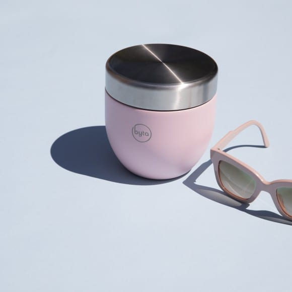 pink sunglasses next to matching byta cup