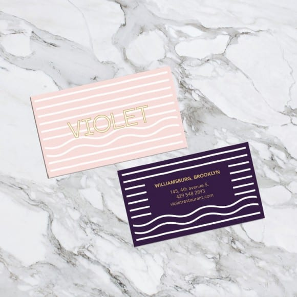 business cards for violet on a marble counter