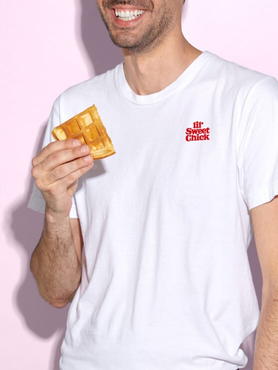 man holding a waffle in a lil' sweet chick branded t-shirt