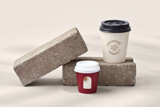 firehouse branded coffee cups posed near bricks