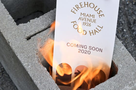 firehouse food hall postcard in a burning cinderblock