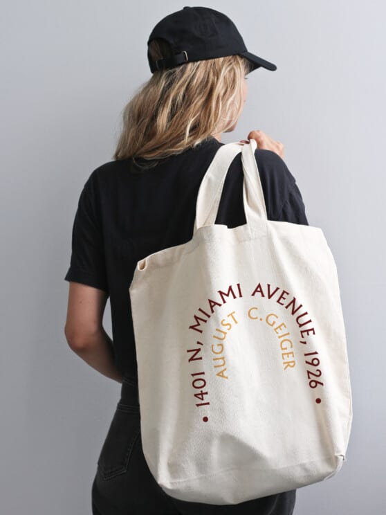 woman in black holding a firehouse branded tote bag