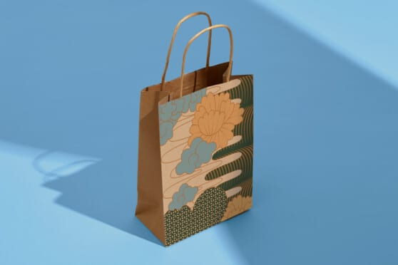a brown paper bag with milu art and branding